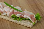 foto of baps  - Bacon sandwich with crisp and salad leaves - JPG
