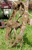 stock photo of plow  - Plowing the soil with electric winch and hand plow - JPG