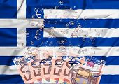stock photo of crisis  - euro banknote dissolving as a concept of economic crisis in greece - JPG