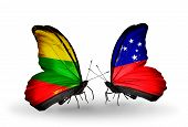 stock photo of samoa  - Two butterflies with flags on wings as symbol of relations Lithuania and Samoa - JPG