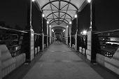 image of pedestrians  - Abstract pedestrian bridge in black and white - JPG