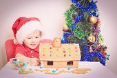 picture of desert christmas  - Smiling boy in Santa - JPG