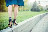 picture of legs feet  - Woman is walking on a sunny day in the park - JPG