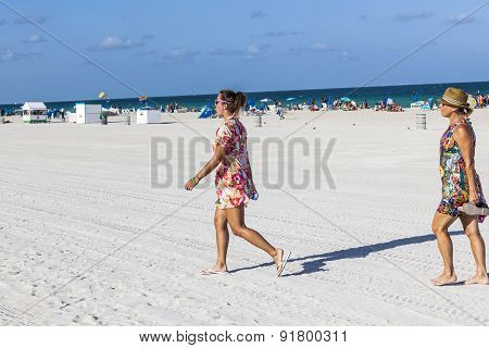 People In Late Afternoon Are Going To Leave The Beach
