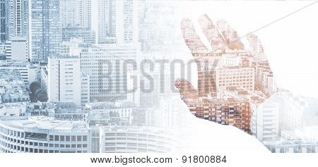 Male Hand And Modern Big City Background