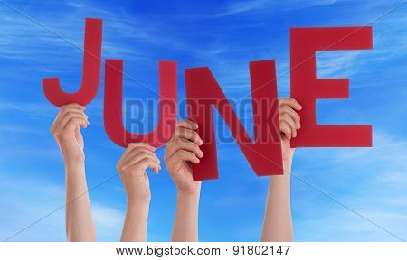 Many People Hands Holding Red Word June Blue Sky