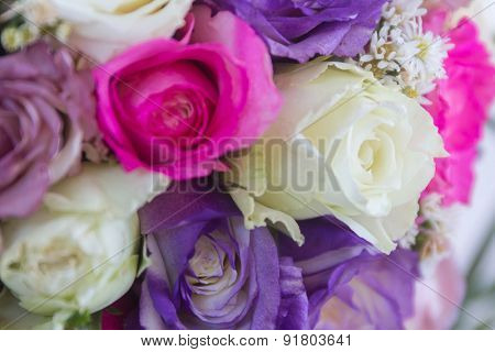 wedding bouquet of white, purple and violet roses