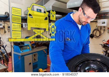 Mechanic working on tire against workshop