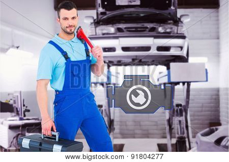 Repairman with toolbox and monkey wrench against auto repair shop