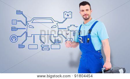 Repairman with toolbox and spanner against grey vignette