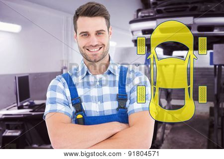 Male handyman standing arms crossed against auto repair shop