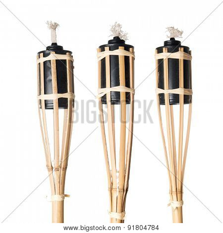 Bamboo torches isolated on white background.