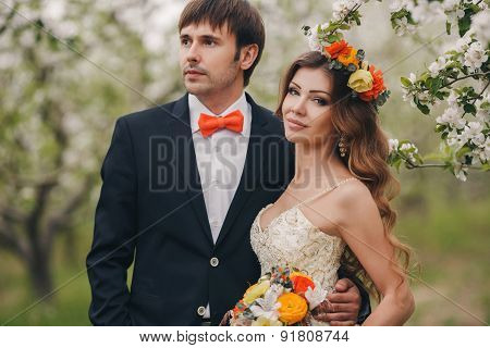 The bride and groom - photo in a flowery Park in the spring.