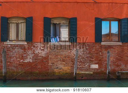 Venetian windows, Italy.