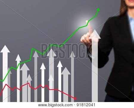 Businesswoman hand drawing growth graph on visual screen.