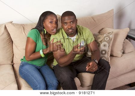 Young Ethnic Black Couple With Remote Control