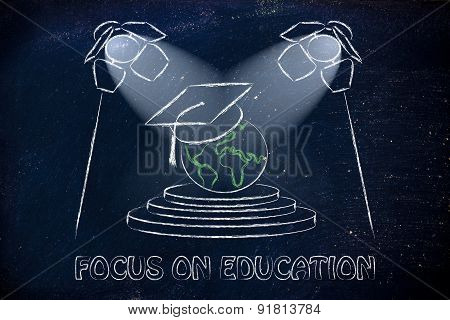 focus on education: world with graduation cap under spotlights