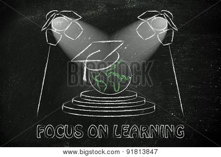 Focus On Learning: World With Graduation Cap Under Spotlights