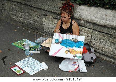Young woman painter on the street