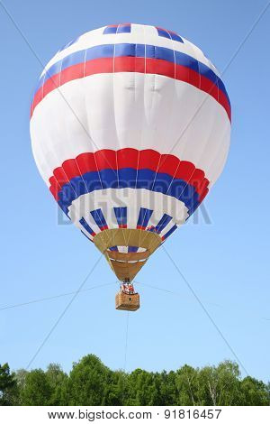 Two women take to the sky in a hot air balloon