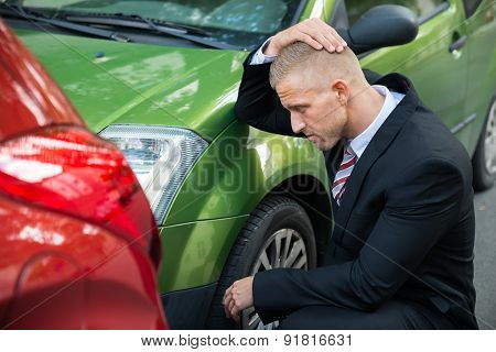 Upset Driver Looking At Car After Traffic Collision