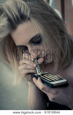 Teenage girl abusing drugs