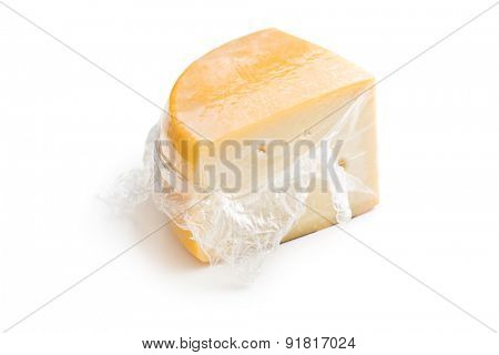 wrapped edam cheese on white background