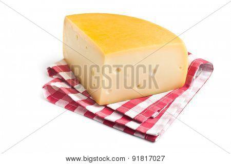 the edam cheese on checkered napkin