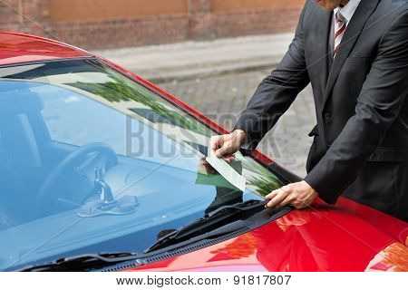 Man Holding A Parking Ticket