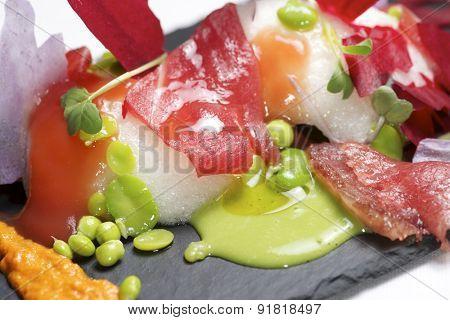 Tuna salad served on a tray slate.