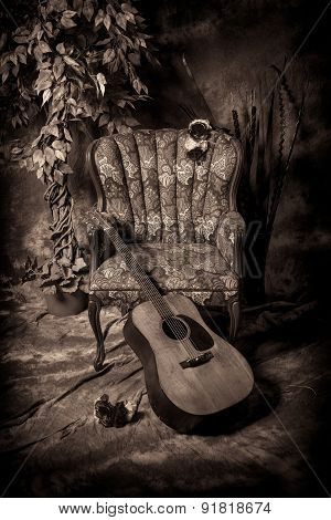 Acoustic Guitar And Empty Chair In Black And White
