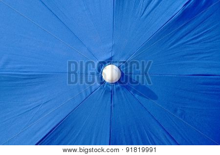 Overview of a blue beach umbrella