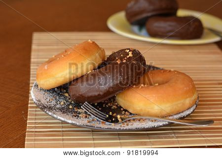 Fresh homemade donuts on the brown plate on the table