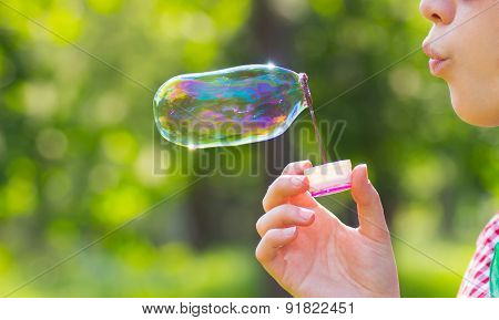 Lips Blowing Big Soap Bubble Outdoor