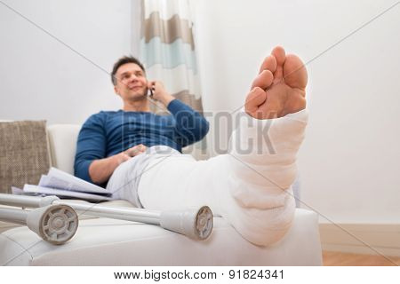 Disabled Man Talking On Cellphone