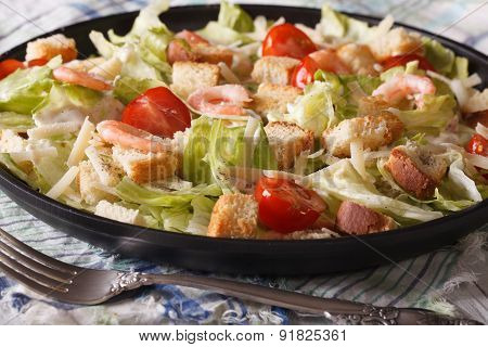 Caesar Salad With Seafood Close-up On A Plate. Horizontal