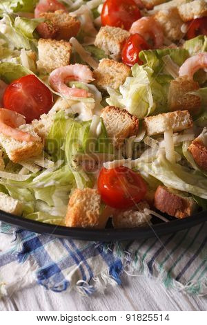 Caesar Salad With Shrimp Close-up On A Plate. Vertical