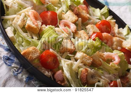 Caesar Salad With Shrimp Close-up On A Plate. Horizontal