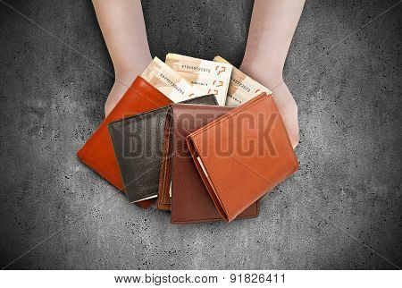 Several Wallets In Their Hands.