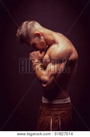 Rome warrior praying on the black background