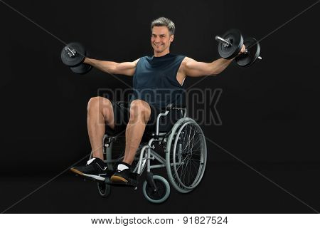 Man On Wheelchair Working Out With Dumbbell