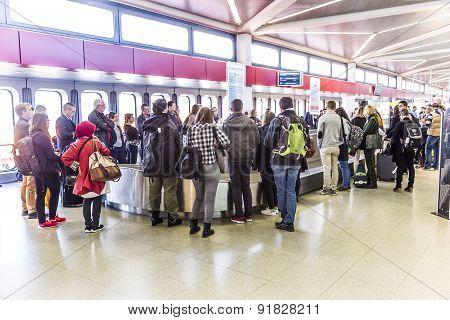 People Wait At Baggage Belt  In  Tegel Airport