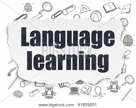 Learning concept: Language Learning on Torn Paper background