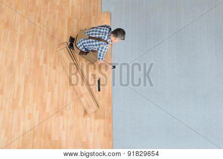 Worker Assembling New Laminate Floor