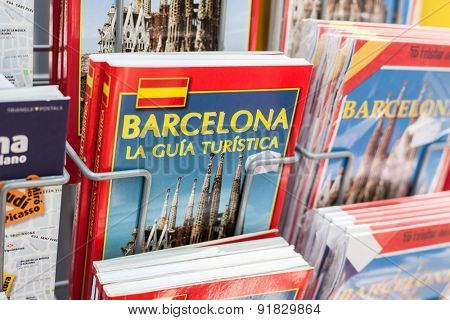 BARCELONA, SPAIN - APRIL, 2015: Barcelona guidebooks offered at market stall on La Rambla