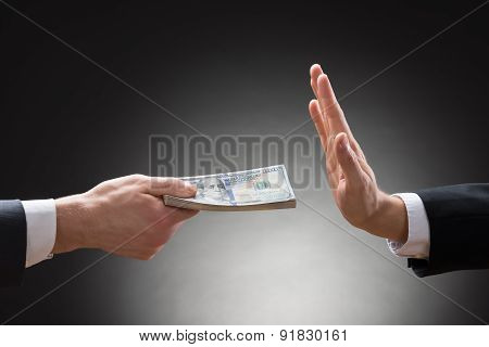 Businessman Hand Rejecting An Offer Of Money