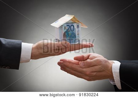 Businessman Giving House To The Businessperson