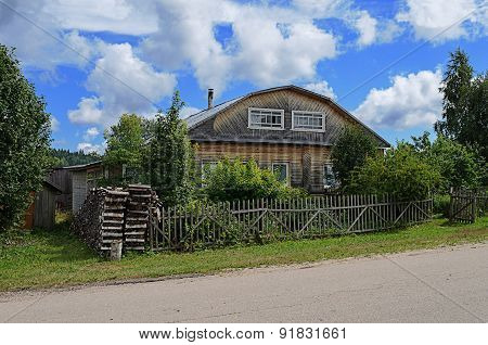 Old Unpainted Wooden House In Village