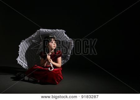 Cute Girl  In  Red Dress With White Parasol