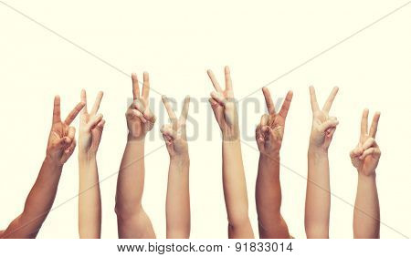 gesture and body parts concept - human hands showing v-sign